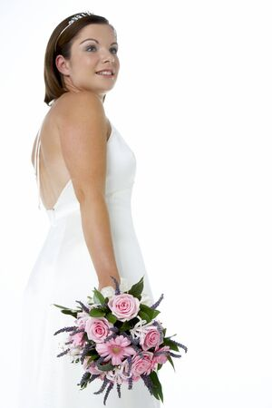 Portrait Of Bride Holding Bouquet Of Flowers photo