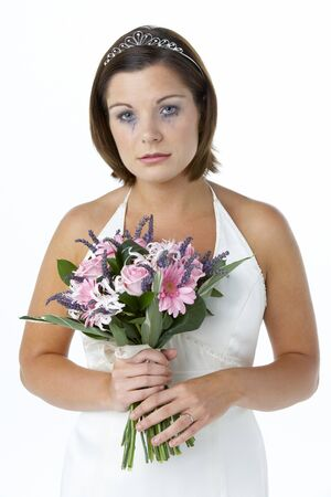 Bride Holding Bouquet And Crying photo
