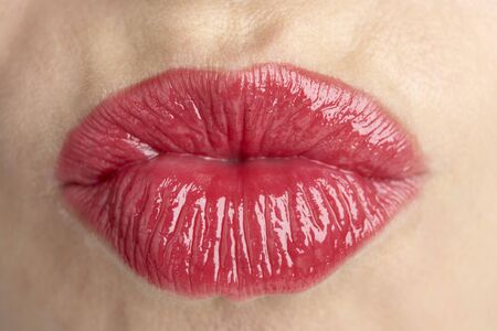 lips kiss: Extreme Close-Up Of Middle Aged Womans Lips Stock Photo