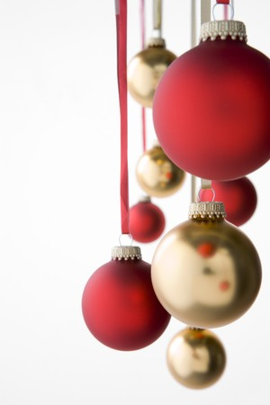 group of christmas baubles: Group Of Red And Gold Christmas Decorations