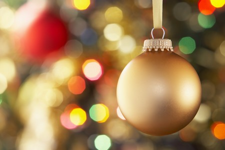 Gold Bauble Hanging On Decorated Tree Stock Photo - 4546220