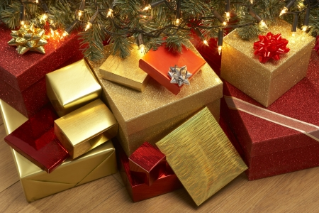 wrapped present: Group Of Christmas Presents Under Tree