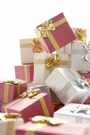 Pile Of Christmas Presents Against White Background Stock Photo - 4546246