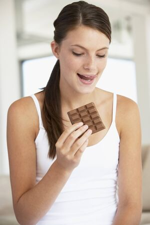 Young Woman Eating Chocolate photo