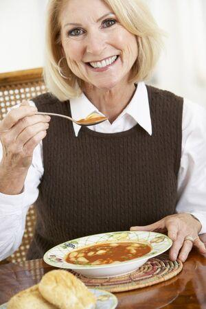 Senior Woman Drinking Soup Stock Photo - 4547108