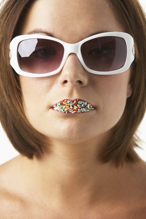 Young Woman Wearing Sunglasses With Sprinkles On Her Lips Stock Photo - 4547180