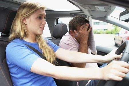near side: Teenage Girl Taking A Driving Lesson