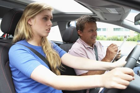 Teenage Girl Taking A Driving Lesson