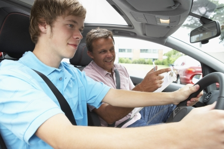 learner: Teenage Boy Taking A Driving Lesson Stock Photo