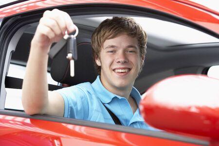 learner: Teenage Boy Sitting In Car Holding Car Keys