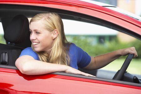 Teenage Girl Sitting In Car photo