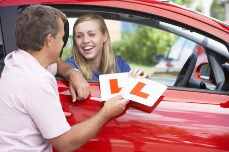 Teenage Girl Receiving Her Learner Plates Stock Photo - 4547281