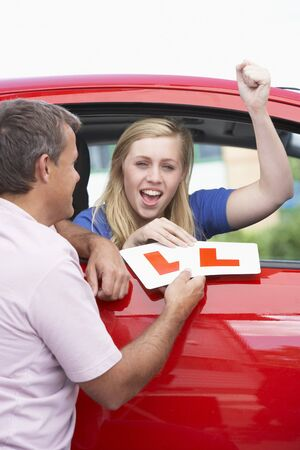 Teenage Girl Receiving Her Learner Plates Stock Photo - 4546779