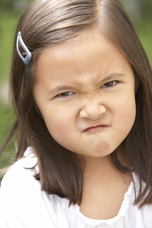 Portrait Of Girl Frowning photo