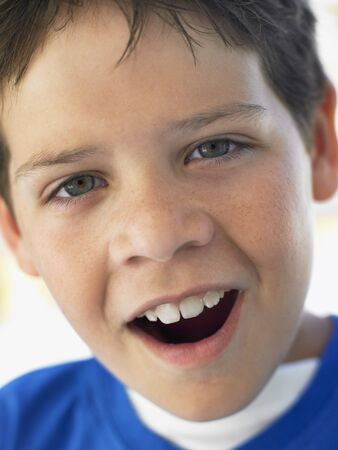 preteen boy: Portrait Of Boy Looking Surprised Stock Photo