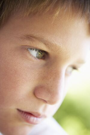 preteen boy: Portrait Of Boy Looking Pensive