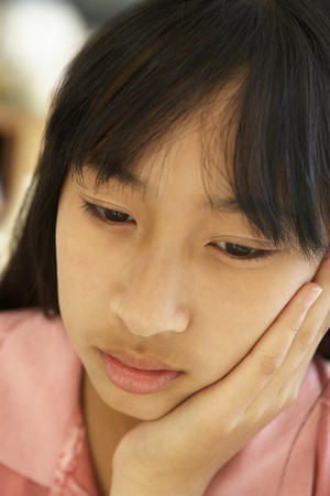 11 year old girl: Portrait Of Unhappy Pre-Teen Girl Stock Photo