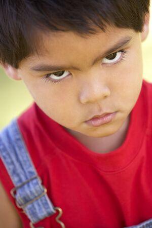 attitude: Portrait Of Young Boy Sulking Stock Photo