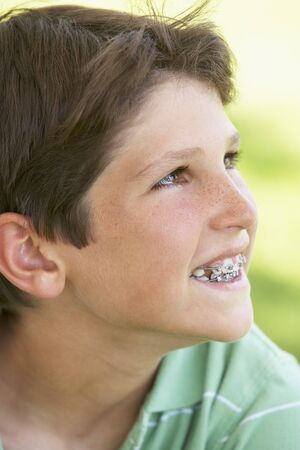 elementary age boy: Portrait Of Boy Smiling