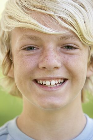 teen boy face: Portrait Of Teenage Boy Smiling Stock Photo