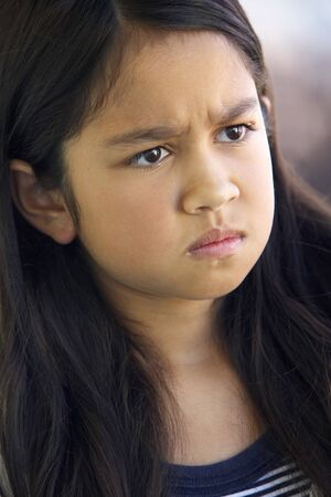Portrait Of Girl Frowning Stock Photo
