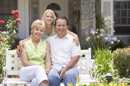 Family Sitting Outside House Stock Photo - 4547366