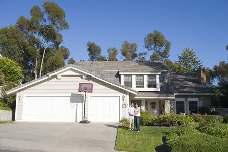 Couple Standing Outside Their House photo