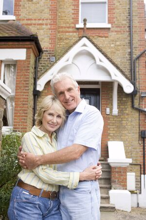 Couple Standing Outside Their House Stock Photo - 4547600