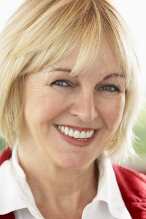 Portrait Of Middle Aged Woman Smiling At Camera photo