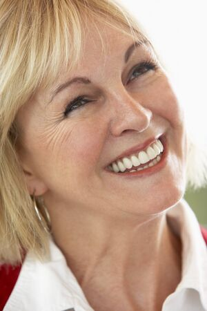 Middle Aged Woman Smiling Cheerfully photo