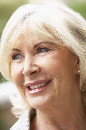 Portrait Of Senior Woman Smiling Happily photo