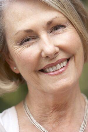 Portrait Of Senior Woman Smiling At Camera photo