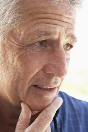 unsure: Portrait Of Middle Aged Man Looking Worried Stock Photo