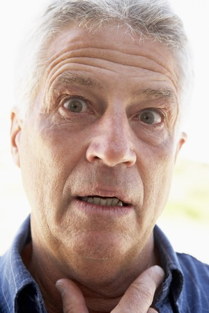 Portrait Of Middle Aged Man Looking Surprised photo