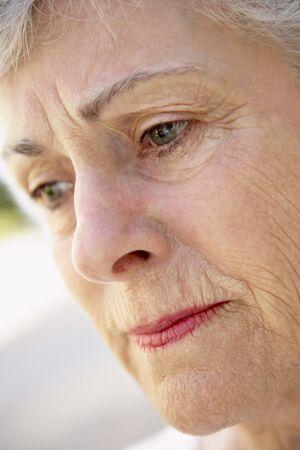 Portrait Of Senior Woman Looking Serious Stock fotó