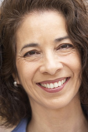 hispanic women: Portrait Of Middle Aged Woman Smiling At The Camera