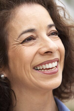 middle aged woman smiling: Portrait Of Middle Aged Woman Smiling