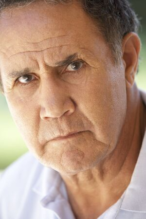 Portrait Of Senior Man Frowning At The Camera photo