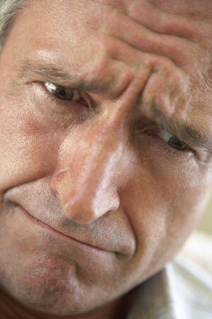 Portrait Of Senior Man Frowning photo