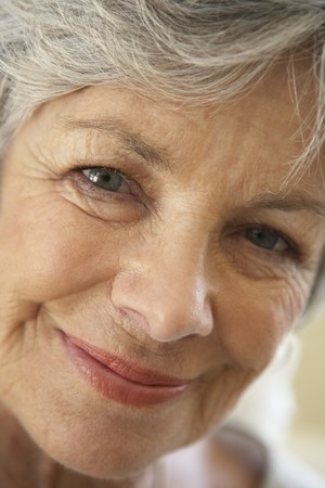 old people smiling: Portrait Of Senior Woman Smiling At The Camera