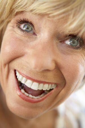 middle aged woman smiling: Middle Aged Woman Smiling Happily Stock Photo