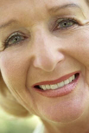 middle aged woman smiling: Middle Aged Woman Smiling At The Camera