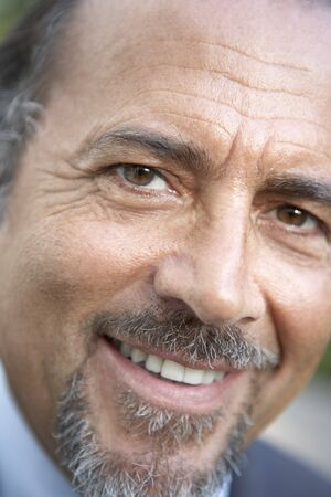 man with a goatee: Portrait Of Middle Aged Man Smiling At The Camera Stock Photo
