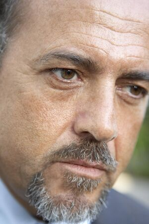 Portrait Of Middle Aged Man Looking Serious photo
