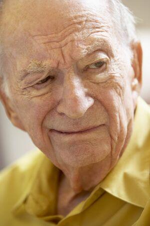 grumpy old man: Portrait Of Senior Man Frowning