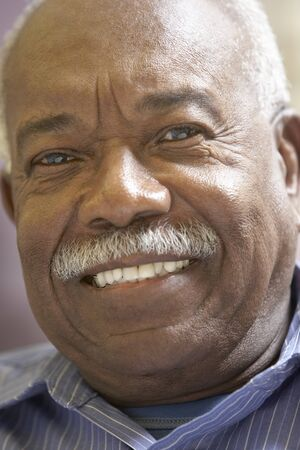 one senior adult man: Portrait Of Senior Man Smiling At The Camera