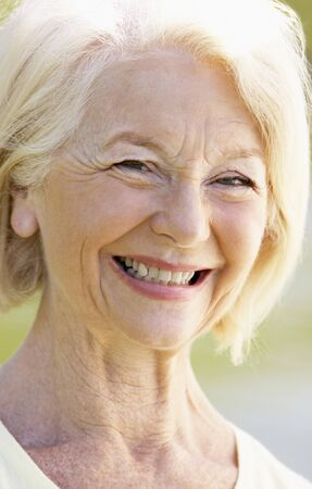 Portrait Of Senior Woman Smiling At The Camera photo