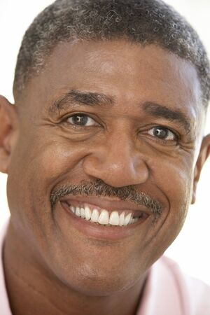 human age: Portrait Of Middle Aged Man Smiling At The Camera Stock Photo