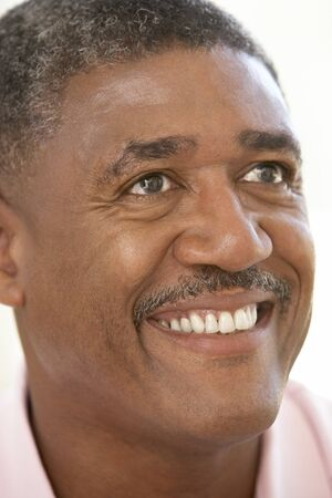 mood: Portrait Of Middle Aged Man Smiling Happily Stock Photo