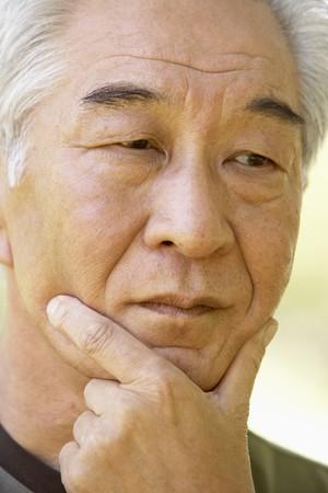 older age: Portrait Of Senior Man Looking Anxious Stock Photo
